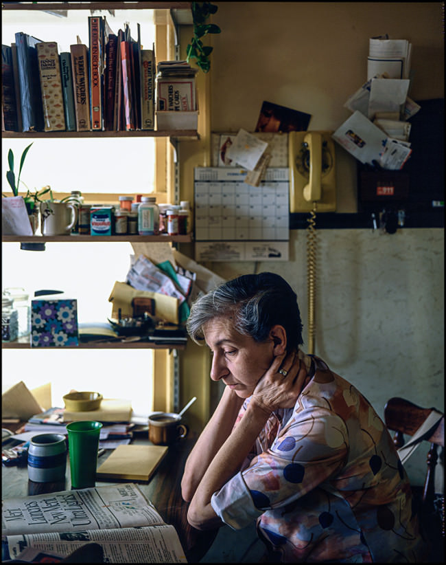 woman reading 1978 © Mike Peters