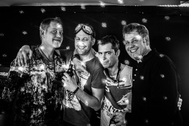 Gruppenfoto von vier Männern
