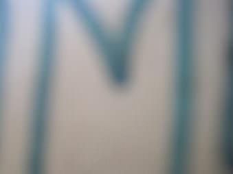 Verschwommene Abbildung des Buchstaben M