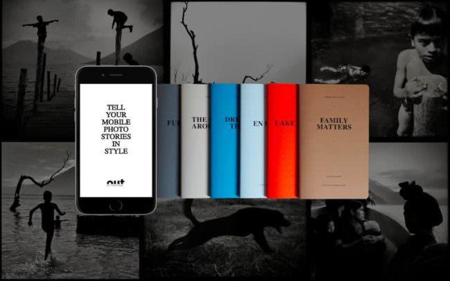 Smartphone und kleine Fotobücher mit schwarzweiß-Bildern als Hintergrund