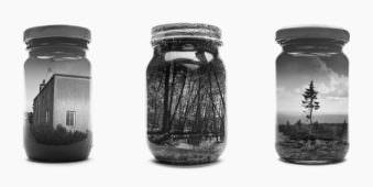 Drei Gläser auf denen Landschaften in schwarzweiß abgebildet sind.