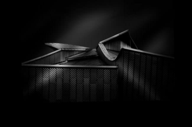 Eine schwarzweiss Aufnahme von abstrakter Architektur.