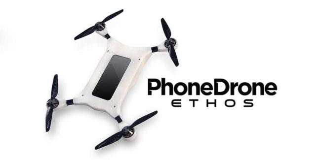 Eine Drohne in der ein Smartphone angebracht ist.
