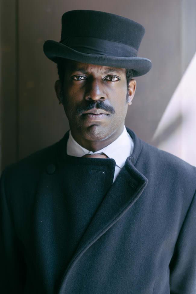 Männerportrait mit Hut