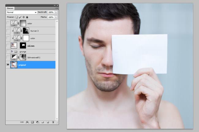 Photoshop Screenshot eines Mannes mit Papier vor dem Gesicht