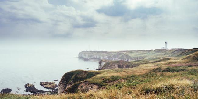 Landschaft mit Leuchtturm