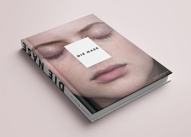 Buchcover Ansicht mit Gesicht darauf.