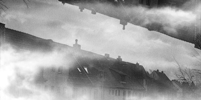 Mehrfachbelichtung Häuser und Wolken