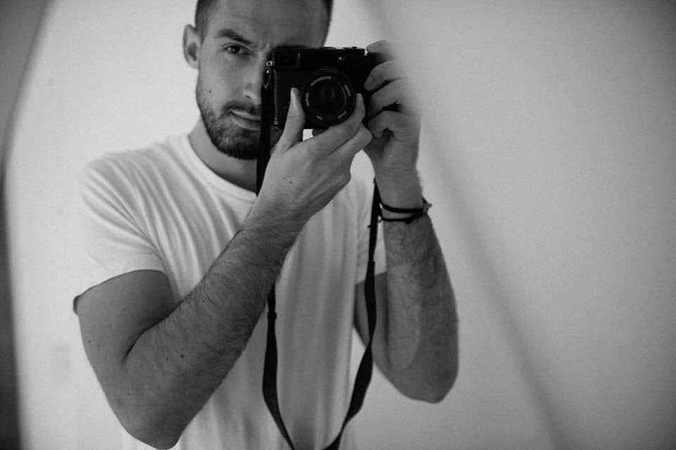 Mann mit Kamera
