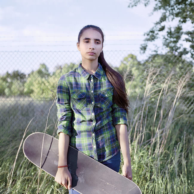 Mädchen mit Skateboard