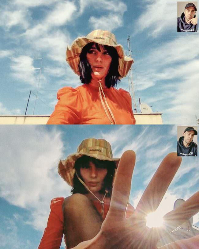 Frau mit Hut unter blauem Himmel