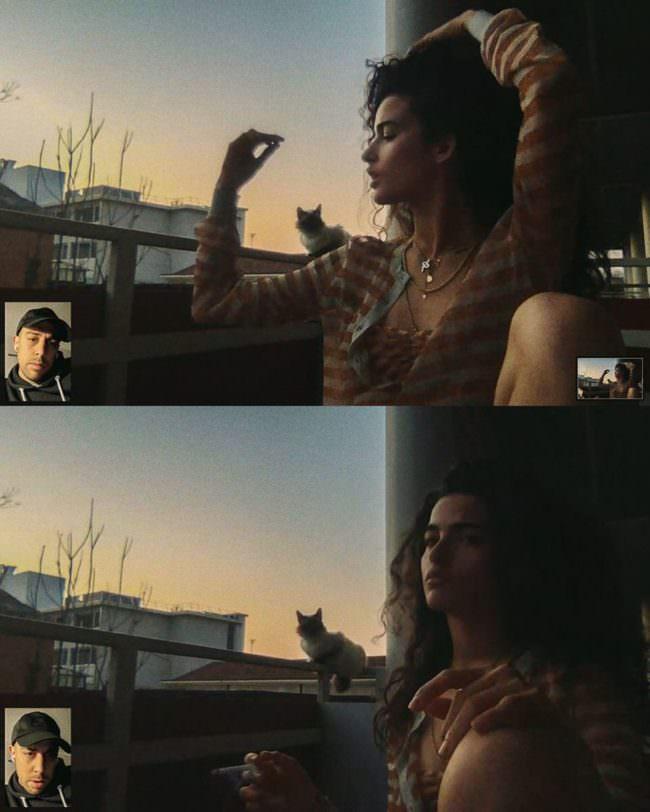 Frau mit Katze auf einem Balkon