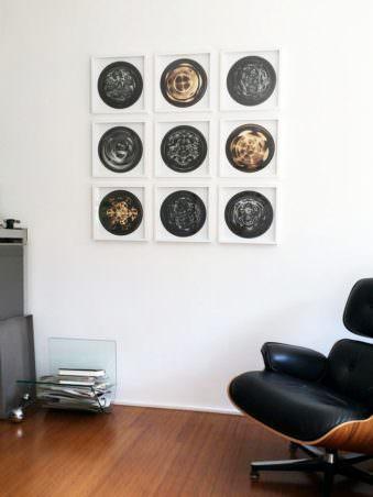 9-teilige Bildserie an einer Zimmerwand
