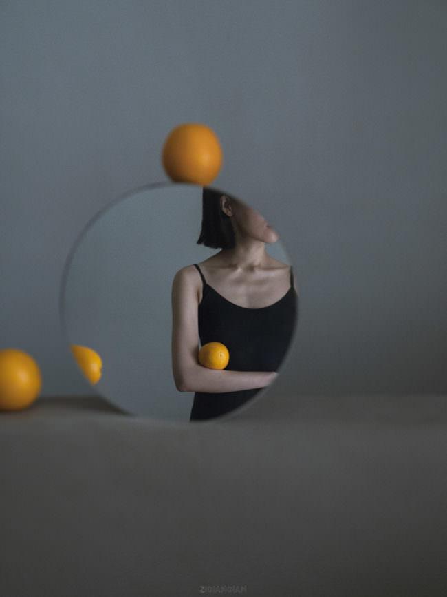Spiegelbild mit Orangen