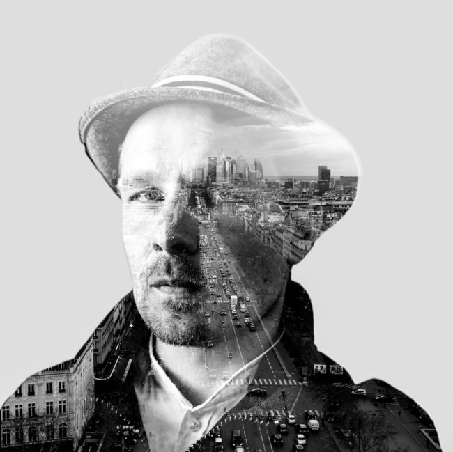 Doppelbelichtung: Mann mit Hut und eine Großstadt