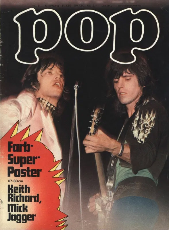 Keith Richard und Mick Jagger gemeinsam an einem Mikrofon auf der Bühne