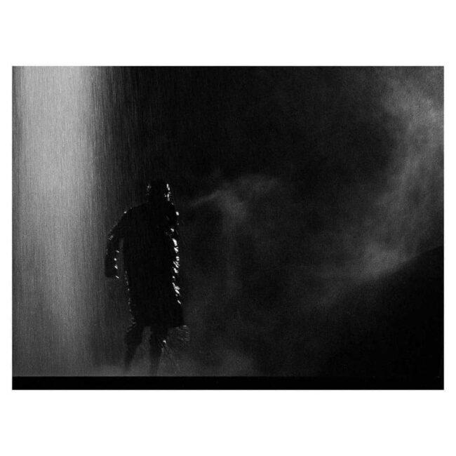 Person im Regen
