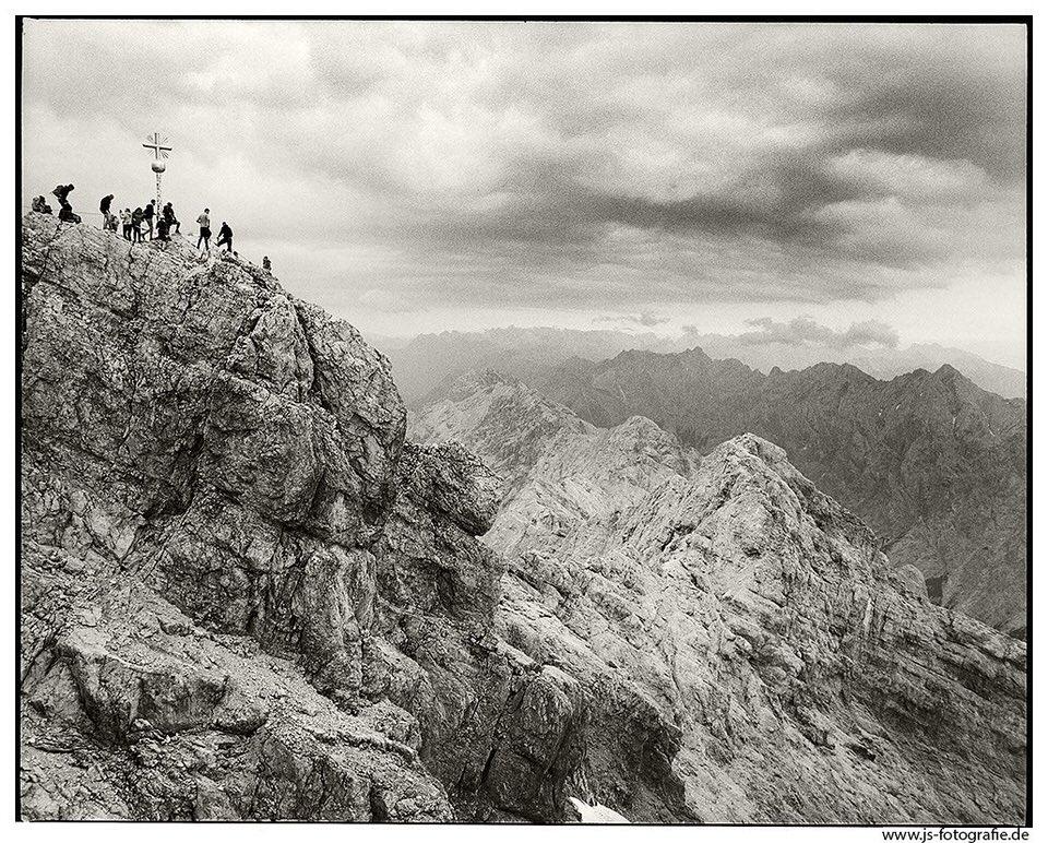 Bergsteiger auf einem Gipfel